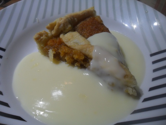 A slice of treacle Tart with custard