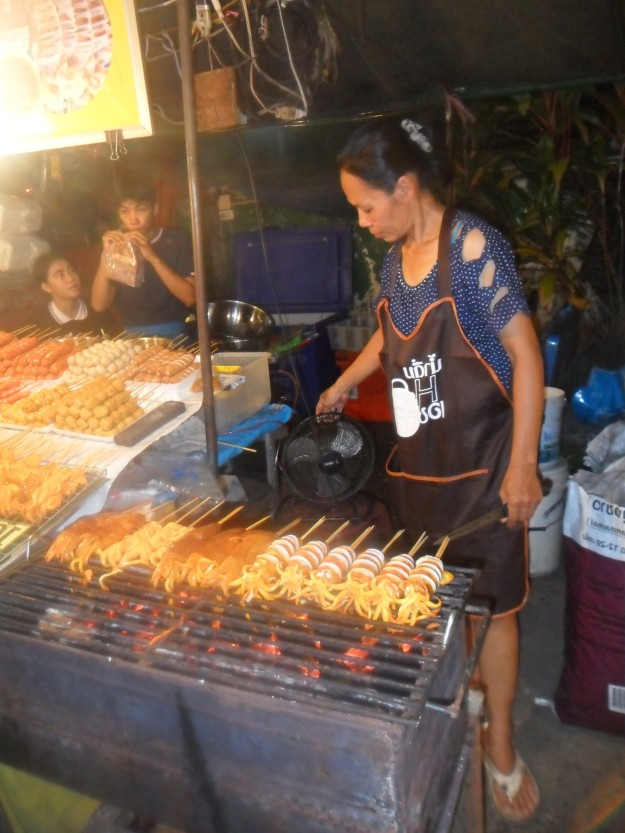 Lady cooking squid