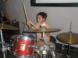 Aston on the drums