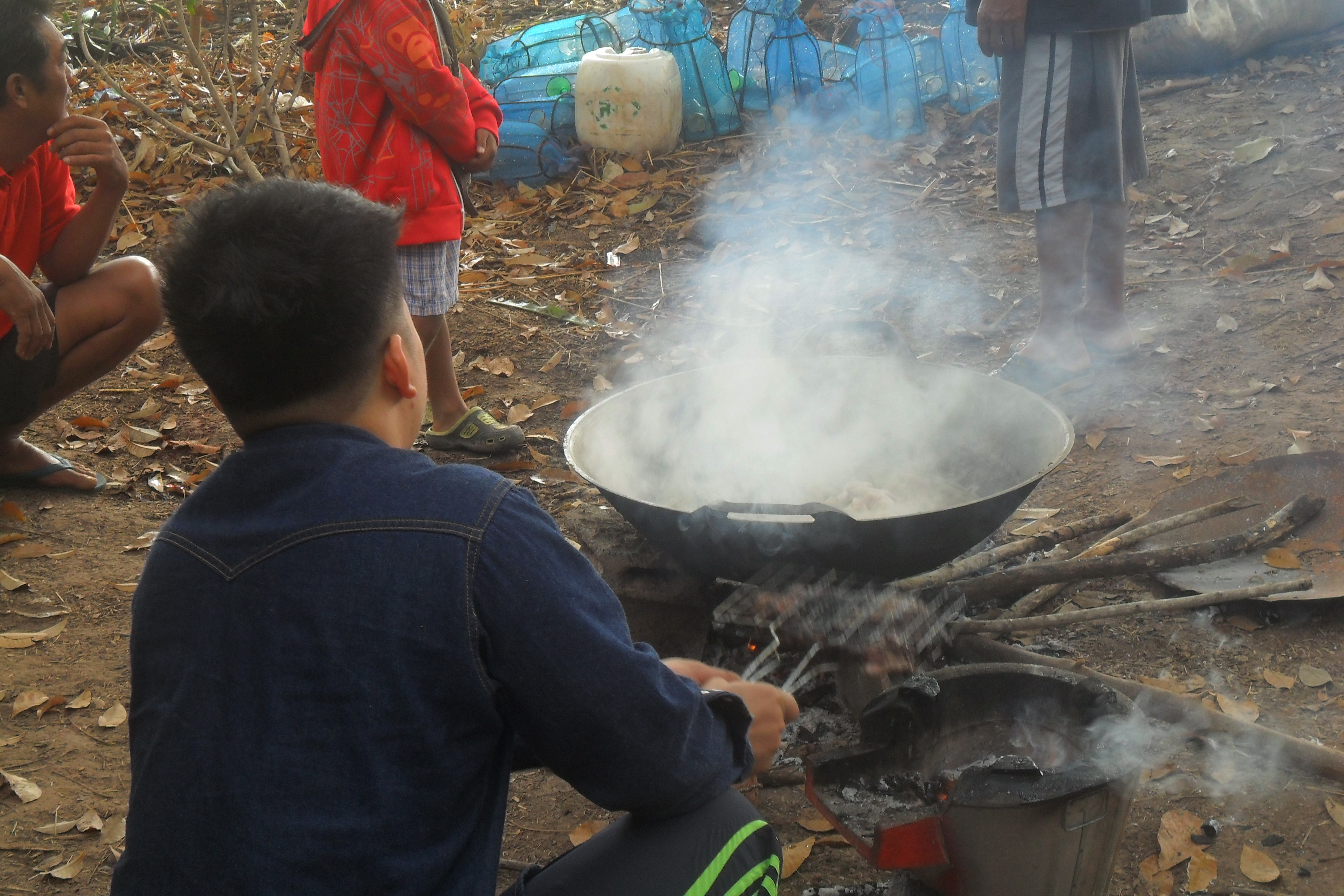 Thailand…Travel and Traditions…Down on the farm making charcoal…