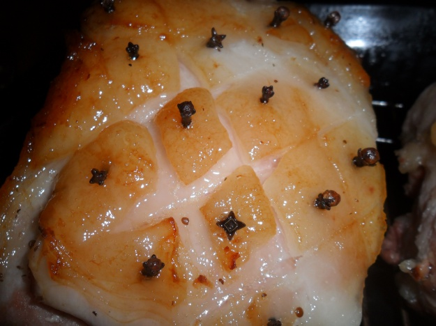 Cooked ham with cloves in skin