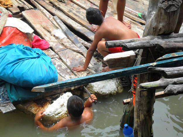 mending the wood boards koh panyee