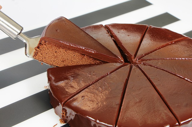 Taking a slice of chocolate cake
