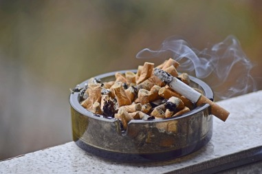 ash tray with smoking cigarette