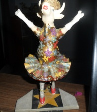 Dancing cow diva figurine