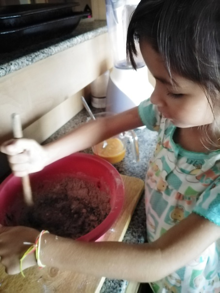 Lily making cupcakes