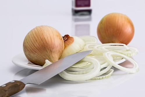 whole onions in skin and sliced onions and knife