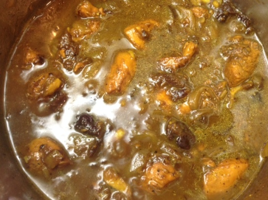 chicken and prunes tagine cooking gently