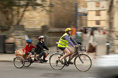 Father and kids on a bike ride