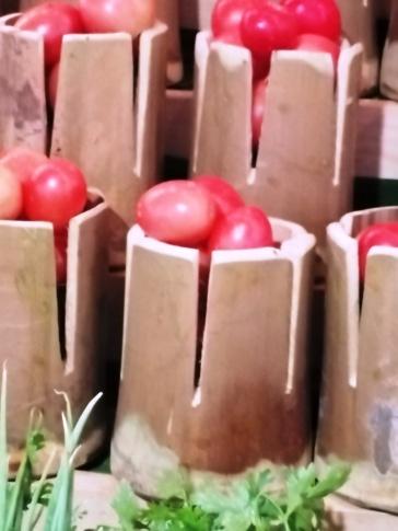 Tomatos in bamboo pot