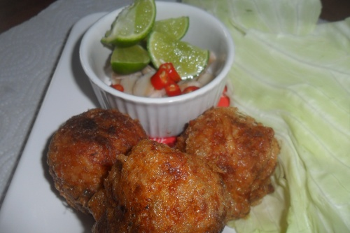 Thai spicy pork balls with dip and white cabbage leaves