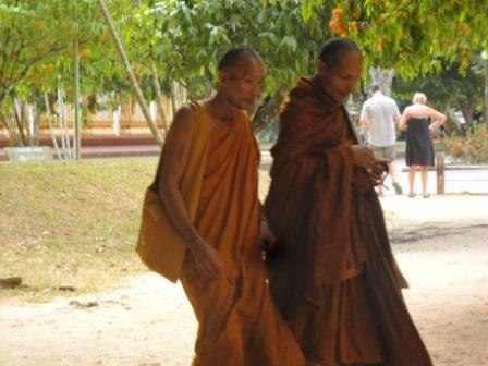 two monks walking