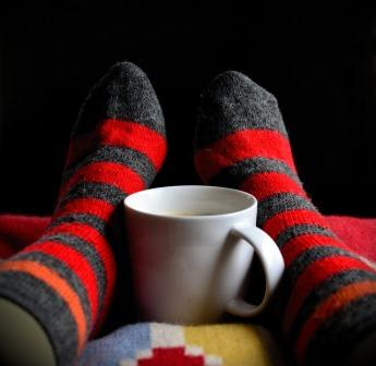 steriped socks feet and coffee