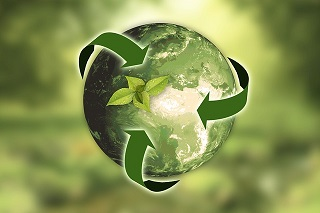 circular recycling the world and a green leaf