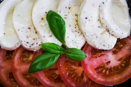 mozzerlla and tomatoes with basil
